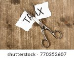 scissors are cutting a piece of ... | Shutterstock . vector #770352607