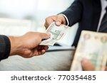 businessman giving money ... | Shutterstock . vector #770354485