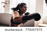 boxer practicing her punches... | Shutterstock . vector #770357575