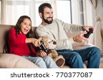 smiling father and daughter... | Shutterstock . vector #770377087