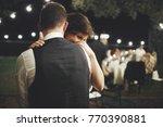 groom hugs bride tender while...   Shutterstock . vector #770390881