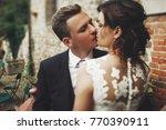 beautiful newlyweds kiss each... | Shutterstock . vector #770390911