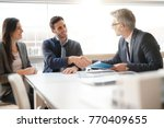 young couple meeting financial... | Shutterstock . vector #770409655