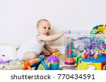 baby boy playing with his toys  ... | Shutterstock . vector #770434591