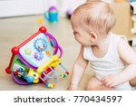 baby boy playing with his toys  ... | Shutterstock . vector #770434597