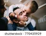 a young family celebrates... | Shutterstock . vector #770435929