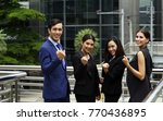 smiling and confident business... | Shutterstock . vector #770436895