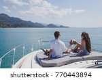 couple enjoying honeymoon... | Shutterstock . vector #770443894