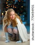 beautiful blonde child girl in... | Shutterstock . vector #770454931
