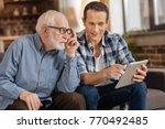 look here. pleasant young man... | Shutterstock . vector #770492485