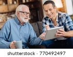 help needed. pleasant senior... | Shutterstock . vector #770492497
