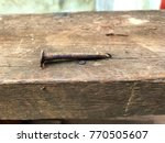 closeup nail rusty on old wood... | Shutterstock . vector #770505607
