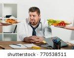 fat businessman choosing... | Shutterstock . vector #770538511