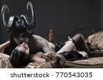 Horned dark haired devil and...