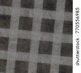 black plaid textile background | Shutterstock . vector #770556985