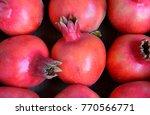 pomegranates group closeup | Shutterstock . vector #770566771