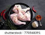 raw chicken quarters  legs in a ... | Shutterstock . vector #770568391