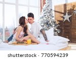 young couple kissing on a... | Shutterstock . vector #770594239