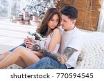 beautiful couple sitting and... | Shutterstock . vector #770594545