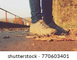 girl in sneakers in the autumn