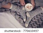 female feet wearing cozy warm...   Shutterstock . vector #770610457
