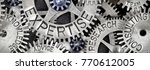 Small photo of Macro photo of tooth wheel mechanism with EXPERTISE concept related words imprinted on metal surface