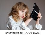 girl playing video game on a... | Shutterstock . vector #77061628