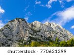 rocky mountain with blue sky... | Shutterstock . vector #770621299