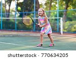 child playing tennis on outdoor ... | Shutterstock . vector #770634205