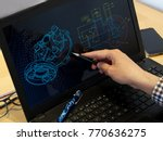 engineer working at computer on ... | Shutterstock . vector #770636275