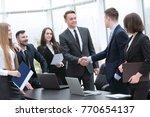 handshake business partners at... | Shutterstock . vector #770654137