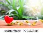 heart model on tape measure for ... | Shutterstock . vector #770660881