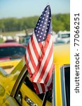 USA stars and stripes flag flown from a car window - stock photo