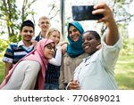 group of students using mobile... | Shutterstock . vector #770689021