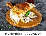 calzone pizza  filled herbs ... | Shutterstock . vector #770692807