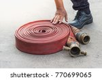 fire extinguisher and fire hose ... | Shutterstock . vector #770699065