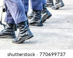 some airmen who used the torn boots was training about the military pose in the marching training with weapon.