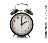 black alarm clock isolated on... | Shutterstock . vector #770717434