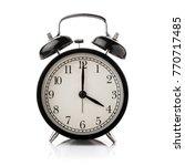 black alarm clock isolated on... | Shutterstock . vector #770717485