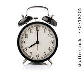 black alarm clock isolated on... | Shutterstock . vector #770718205