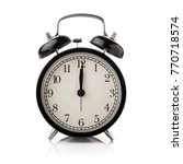 black alarm clock isolated on... | Shutterstock . vector #770718574