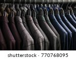 Row Of Men Suit Jackets On...