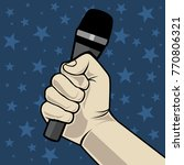 hand with microphone. on a blue ... | Shutterstock .eps vector #770806321
