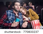 frightened couple with popcorn... | Shutterstock . vector #770833237
