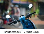 a motorbike is parked outside a ...   Shutterstock . vector #770853331