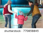 back view of young family with... | Shutterstock . vector #770858845