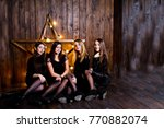 four cute friends girls wear... | Shutterstock . vector #770882074