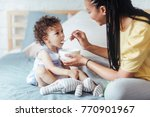 african woman giving her baby... | Shutterstock . vector #770901967