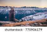 a girl sit perched on a rock...   Shutterstock . vector #770906179