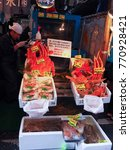 Small photo of TSUKIJI TOKYO, JAPAN - NOV 2017 :Fresh sea shell, scallop,seafood stall.Hokkaido giant crab,Alaska king crab on ice sell in Sapporo Hokkaido or Tsukiji fish market (street food) in Tokyo Japan